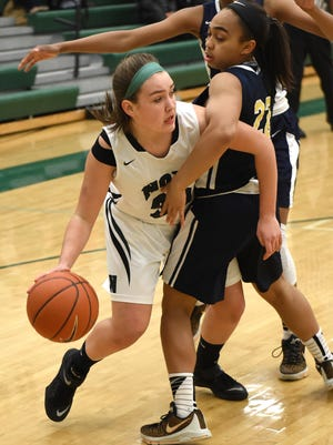 Novi's Bailey Baumbick, left, tries to find a way to pass around the defense of Wayne Memorial's Camree Clegg.