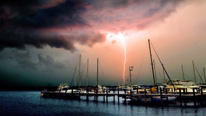 Severe thunderstorms and lightning rolls across Brevard County Thursday afternoon in foreground Whitley Bay Marina Cocoa .