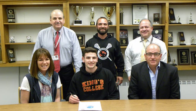 Glen Rock High School senior Trevor Douenias is joined by his parents Christine and Rami Douenias as he signs his commitment letter to play Division 3 lacrosse for King's College in Pennsylvania. Also on hand to congratulate Trevor are Glen Rock High School Principal John Arlotta, Varsity Boy's Lacrosse Coach Michael Escalante, and Director of Athletics Frank Violante. Trevor is a four-year varsity lacrosse player at midfield and is a faceoff specialist for Glen Rock; he has been one of the team's top players for the past four years. Trevor has been a tremendous leader for the team serving as captain for the 2017 season. He will continue his career as a midfielder for King's.