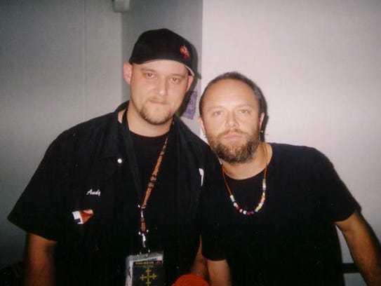 Andy Hall, left, poses for a photo with Metallica drummer