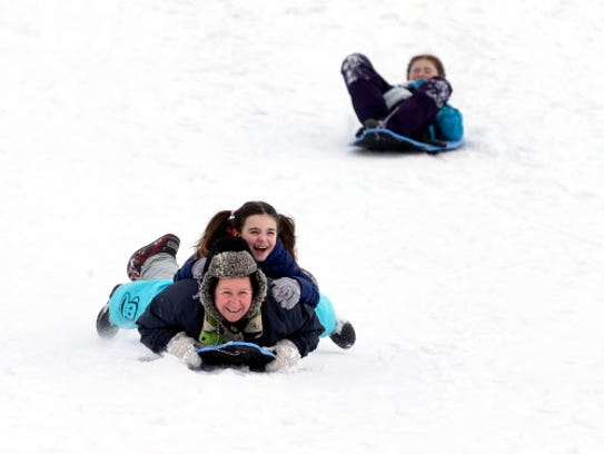 Sledding with the kids is a great way to spend a snow