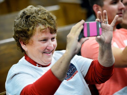 Henderson city commission candidate Patti Bugg takes a picture of the polling results in this file photo.