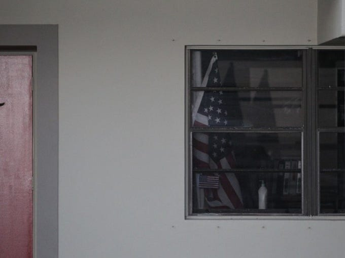 An American flag is seen in another apartment at the Fort Pierce apartment building where Orlando Pulse shooting suspect Omar Mateen resides.