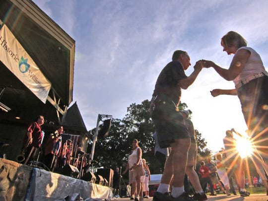 People dance to the beach music from Carolina Coast Band during the Springwater Festival in Minerals Springs Park in Williamston.