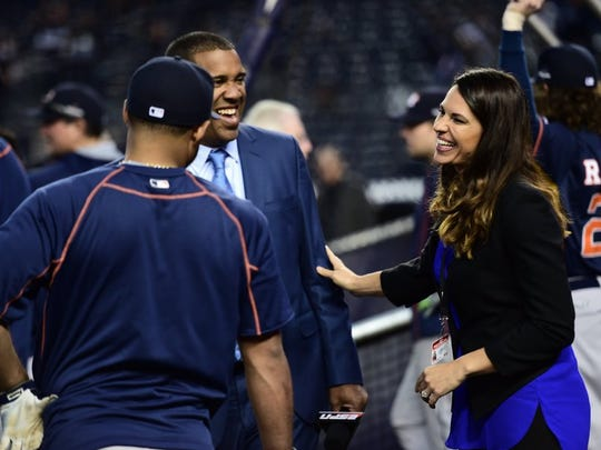 COURTESY OF BEN SOLOMON/ESPN IMAGES Camarillo High graduate Jessica Mendoza (right) talks with ESPN analyst Eduardo Perez before a wild-card playoff game at Yankee Stadium last October.