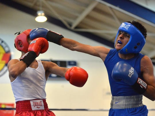 Alejandro Dominguez, left, and Juan Medina are seen in this file photo taking during the 42nd annual National PAL Boxing Championships in Oxnard.