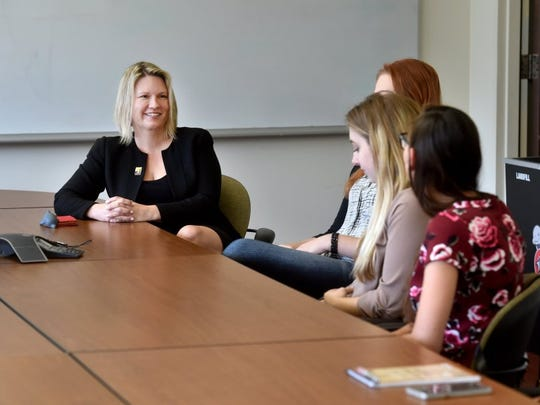 ANTHONY PLASCENCIA/THE STAR Erika Beck (left), the new president of CSU Channel Islands, meets with a group of student leaders Monday during her first day on the job.