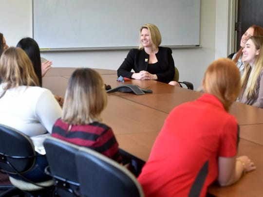 Erika Beck (center), the new president of CSU Channel Islands, meets with a group of student leaders Monday during her first day on the job.