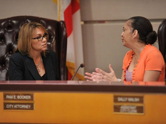 Port St. Lucie City Councilwoman Michelle Berger (left) talks with City Attorney Pam Booker during a break Tuesday in a special meeting of the Port St. Lucie City Council. The council voted to fire Booker.