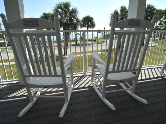 Accessorized with rocking chairs, the porch of the
