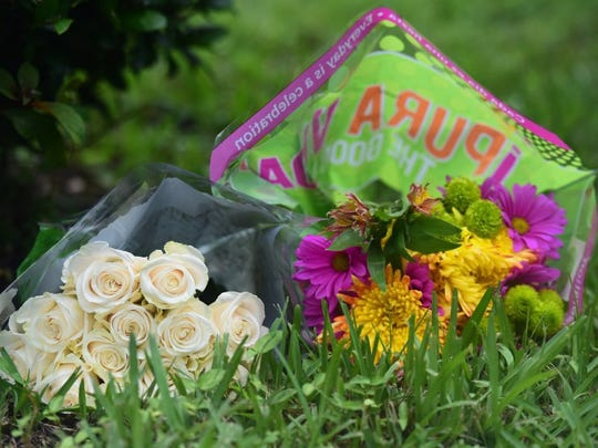 Flowers were left in front of the Tequesta home of John Stevens III and Michelle Mishcon, who were murdered Monday night at their home. Nineteen-year old Austin Harrouff is the alleged suspect in the killings.
