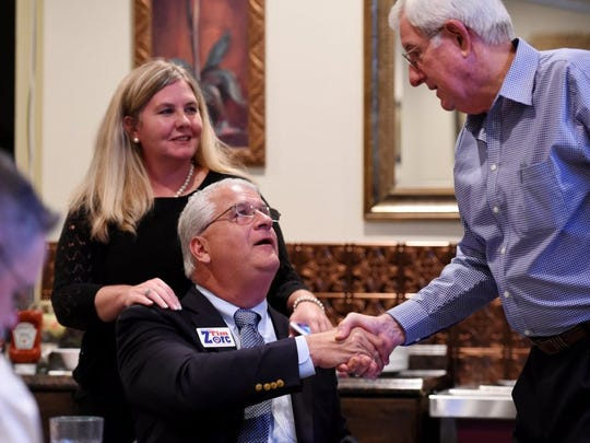 Newly elected Indian River County School Board member Laura Zorc watches as husband, Tim, re-elected as county commissioner Aug. 30, 2016, accepts congratulations from Charles Searcy, right. Laura Zorc will be one of two incumbents when a new School Board is sworn-in after the 2018 elections. Searcy is one of three School Board incumbents who declined to seek re-election.