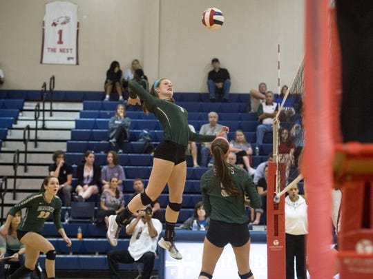 September 1, 2016 — Briarcrest High School volleyball player Carsyn Starr jumps toward the ball during a match against St. Benedict at Auburndale High School at SBA.