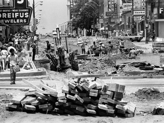 June 17, 1975 — Foot traffic was treacherous as workers were transforming Main Street into the Mid-America Mall on June 17, 1975.