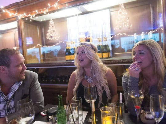 A table of friends celebrating New Year's Eve at Sapphire, Thursday, December 31, 2015.