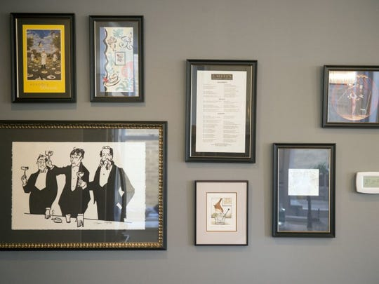 This kitchen wall holds framed menus from the Hawks- travels and a drawing by Creason Clayton, identical to one that Cliff had long admired at F. Scott-s, one of their favorite restaurants in Nashville. Jacque commissioned the drawing from the artist as a birthday surprise for Cliff.