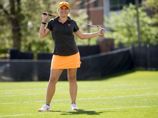 SAUL YOUNG/NEWS SENTINEL Tennessee sophomore golfer Anna Newell shows off her mismatched socks at Haslam Field last Thursday.
