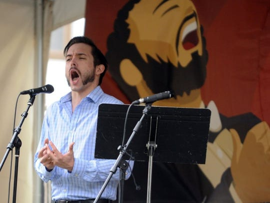 Tenor Ian McEuen takes the Opera Stage at the Rossini Festival in downtown Knoxville on Saturday, April 23, 2016. (CAITIE MCMEKIN/NEWS SENTINEL)