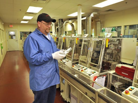 Associate Mike Bott works March 28, 2012 at DENSO Manufacturing Tennessee in Maryville. (Steve Morrell/DENSO)