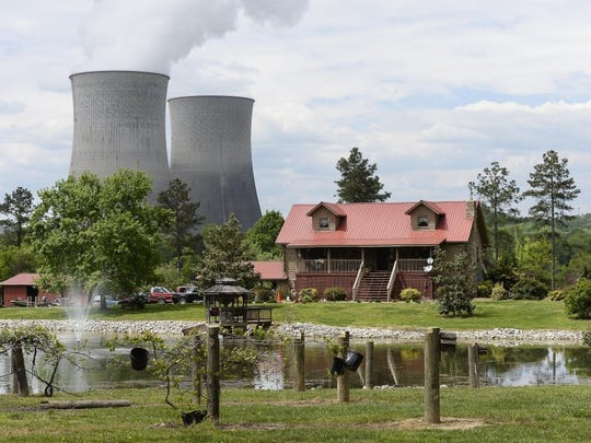 A home sits within view of the Watts Bar Nuclear Plant cooling towers Unit 1, left, and Unit 2 near Spring City, Tenn., in April 2015.