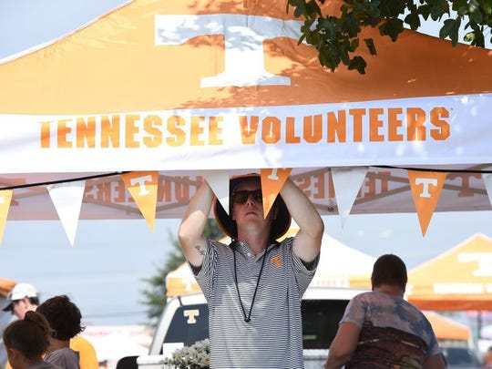 Drew Tice, a UT student and Nashvillian, hangs flags while tailgating before the season opening game against Bowling Green State University in Nashville Saturday, Sept. 5, 2015. (AMY SMOTHERMAN BURGESS/NEWS SENTINEL)
