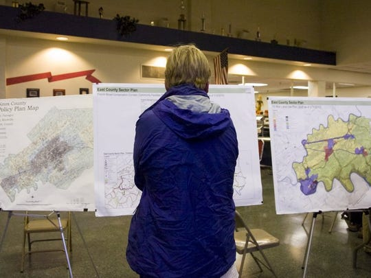 Maps and drawings on display during a public meeting at West High School on Nov. 18, 2010, regarding the proposed Midway Business Park. FILE/SAUL YOUNG/NEWS SENTINEL