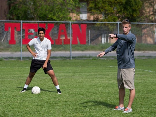 COURTNEY SACCO/CALLER-TIMES Ray High School's head boys soccer coach Ben Bishop givers his players instructions during a practice Wednesday at Ray High School. Bishop led to the Texans to their first playoff appearance since 2009.