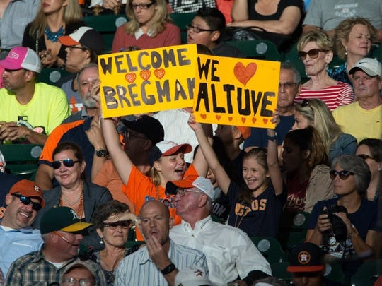 COURTNEY SACCO/CALLER-TIMES A fan in the sands at Minute Maid Park holds up a sign that reads 'Welcome Bregman' during Alex Bregman's second game with the Astros on Tuesday. Bregman was greeted with a standing ovation prior to his first at-bat on Monday against the Yankees.