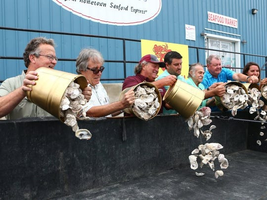"COURTNEY SACCO/CALLER-TIMES The owners of Groomer's Seafood and Texas A&M-Corpus Christi officials celebrated the one millionth pound of oyster shells collected through the ""Sink Your Shucks"" oyster recycling program by dumping oyster shells into a collection trailer outside of Groomer's Seafood on Tuesday, Aug. 16, 2016."