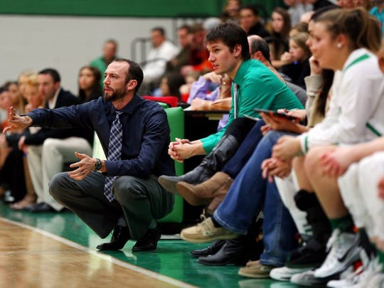 Standard-Times file Wall High School head girls basketball coach Tate Lombard shouts directions from the sidelines during a game last season. He has coached the Lady Hawks to their first state title in 2014, and they-re two wins away from another crown this year.