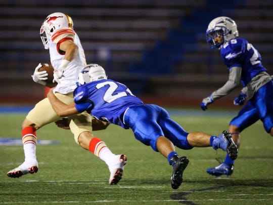 Lake View's Frank Muniz tackles Lubbock Coronado's Cameron Stevenson Friday, Oct. 7, at Angelo Stadium.