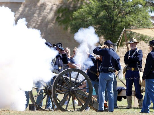 Fort Concho re-enactors fire a canon signaling the top of the hour at last year's Frontier Day.