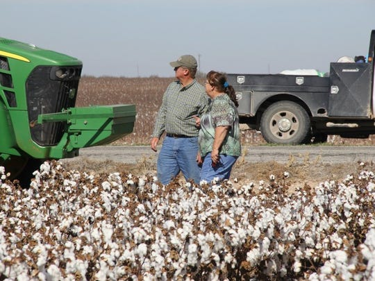 Donald and Sharon Braden stand on their 7,000-acre farm in Reagan County.