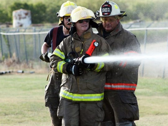 James Moerls, a volunteer firefighter with the Clyde VFD practices hose nozzle operation at a conference at the Abilene Fire Department fire training facility. The Abilene City Council votes Thursday to approve design services for a new training facility, which will enhance opportunities for both Abilene firefighters and those in the area.