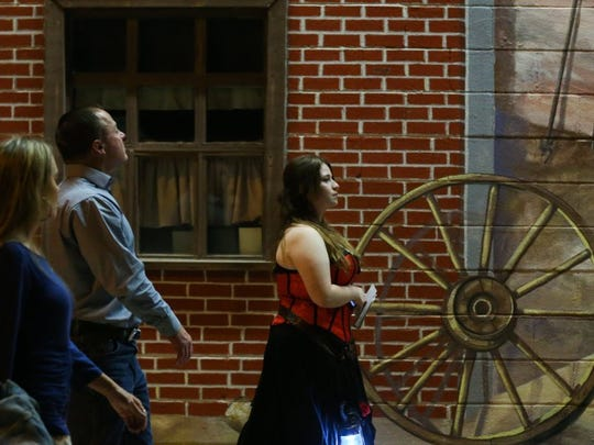 Alison Morantes leads participants down Oakes Street during Be Theatre's Ghost Walk Saturday, Oct. 15, 2016 in downtown San Angelo.