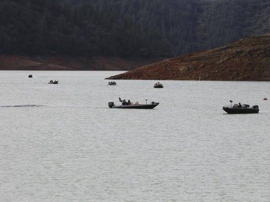 File photo - In 2016, anglers fish at Bridge Bay on Lake Shasta.