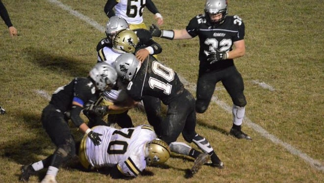 Robbinsville players make a tackle in last week's playoff win over Hayesville.
