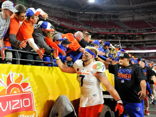 In this 2014 file photo, Boise State celebrates a Fiesta
