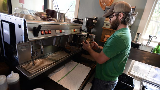 Matt Cassity works on a customers order at Rhino Coffee.