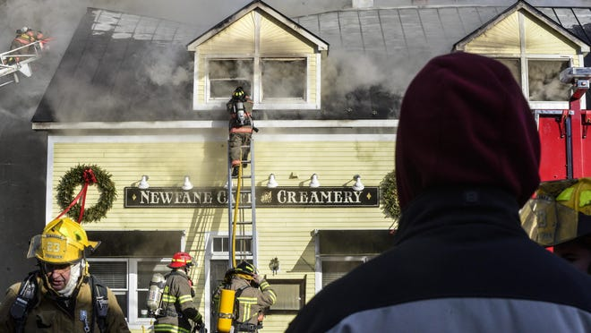 A group of onlookers watch as several departments responded to a fire that destroyed the Newfane Cafe and Creamery in Newfane onWedensday,. The cause of the fire was under investigation.