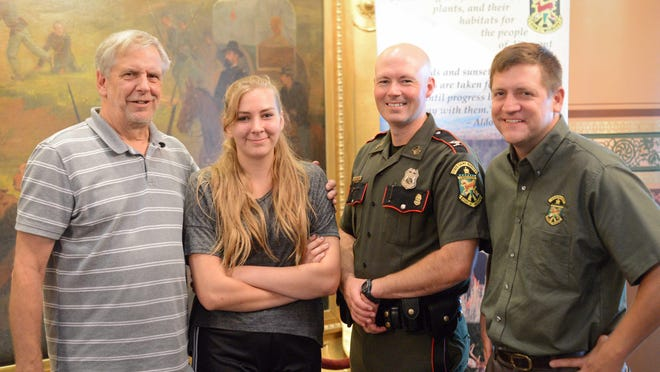 Paul Giacherio from Washington, Vt., was a winner of one of 160 moose hunting permits issued in the 2016 lottery. He attended the live drawing this morning at the Statehouse with his granddaughter, Bryanna Giacherio, who also put in for a moose permit. The happy pair are pictured with Chief Warden Col. Jason Batchelder and Fish & Wildlife Commissioner Louis Porter.