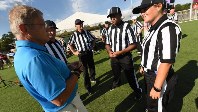 Referees meet before the 2017 BB&T Jamboree at Legion Stadium. Local officials are eager to return, but do have questions about safety protocols with the ongoing COVID-19 pandemic.