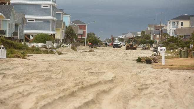 West Beach Drive in Oak Island is full of sand on Thursday Aug. 6, 2020 following Hurricane Isaias.