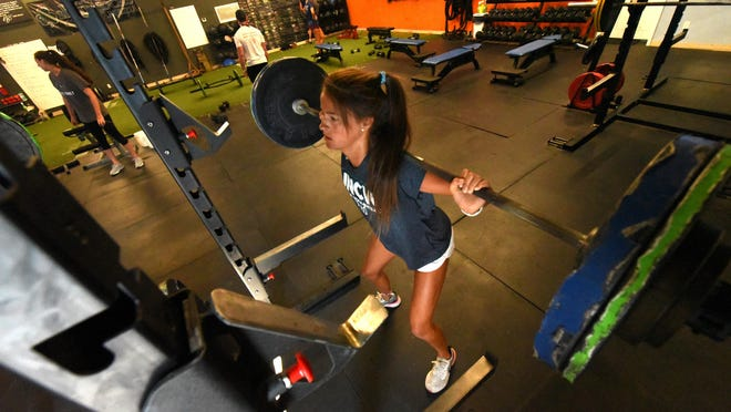 Ayla Johnson goes through a workout Wednesday July 15, 2020 at Legends Training Complex in Wilmington. Some local athletes are using the private gym, owned by John Rhodes, to stay in shape during the coronavirus pandemic.