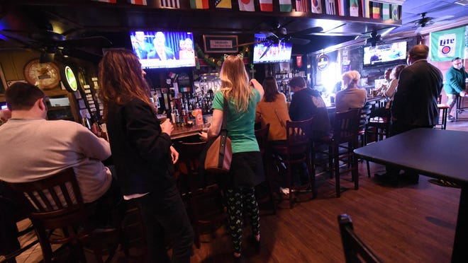 Gov. Roy Cooper announced Tuesday that restaurants will have to end alcohol sales at 11 p.m. starting Friday. Bars also are to remain closed as North Carolina continues efforts to try and limit the spread of the coronavirus.