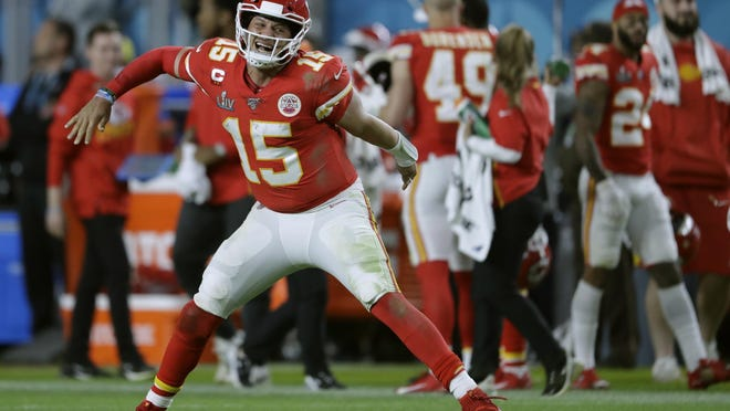 Kansas City Chiefs quarterback Patrick Mahomes celebrates a touchdown pass during Super Bowl 54 on Feb. 2 in Miami Gardens, Fla. Mahomes, who led the Chiefs to their first championship in 50 years, agreed to a contract extension Monday through the 2031 season.