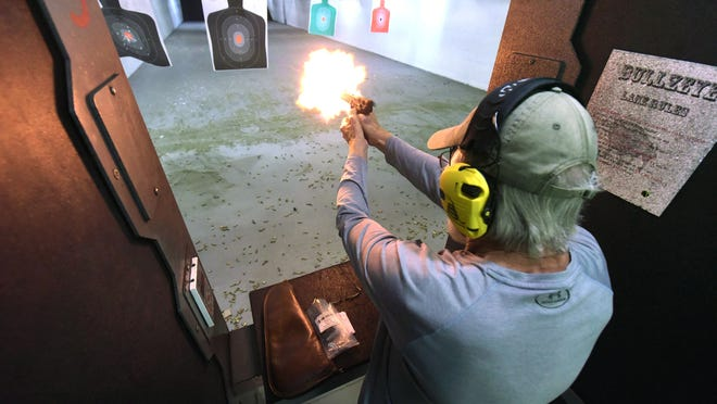 Ron McKee shoots on the firing range while taking a concealed carry class from Firearms Instructor Tony Wisyanski Friday Sept. 11, 2020 at BullZeye Shooting Sports in Wilmington, N.C.  With a surge in gun sales this year, starting with COVID-19 and cresting after protests broke out many people have started taking concealed classes.