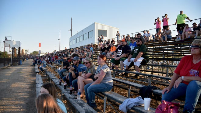 Fans watch their favorite drivers compete during a race last June at Salina Speedway. The racetrack, located at 2841 S. Burma Rd., will hold an open practice Friday night with the first night of racing Saturday.