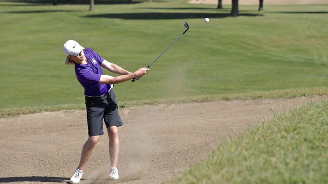 Cade Bastian, who led a balanced Hononegah team with a score of 79, hits out of the sand during the Class 3A Rockford East regional boys golf tournament on Tuesday at Elliot Golf Course in Cherry Valley.