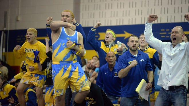 Buena wrestlers and coaches celebrate a victory by James Rodriguez over Gateway's Griffin Mills. Staff photo/Charles J. Olson